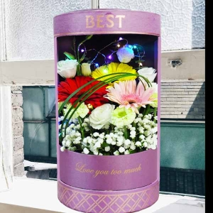 LED Light With 3 Gerbera & White Eustoma In Round Gift Box