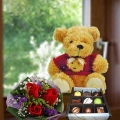 "8"" Bear with Praline Chocolate 9 pcs & 3 red roses handbouquet."