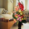 Artificial Flowers In Tall Vase Arrangement.