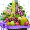 Pink Lily & Orchid With Mixed Fruits Basket Arrangement