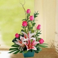 Pink Lilies And Roses Table arrangement