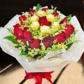 12 Red Roses With Rochers Hand Bouquet Valentine Delivery