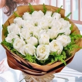 20 White Roses In Brown Wrapping Paper Hand Bouquet