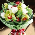 Fresh Cymbidium Orchid, White Roses With Artificial Berries & Leaves Bouquet