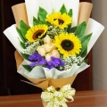 3 Sunflowers and 6 Champagne Roses Handbouquet